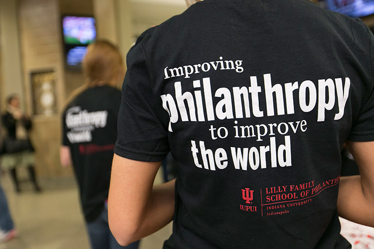 improving philanthropy to improve the world on back of t-shirt