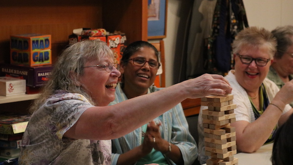 Advancing Mission - friends playing jenga