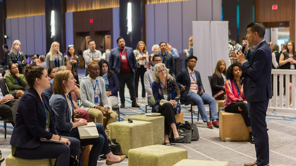Participants standing, others sitting on cubes. Upswell 2019 in Chicago