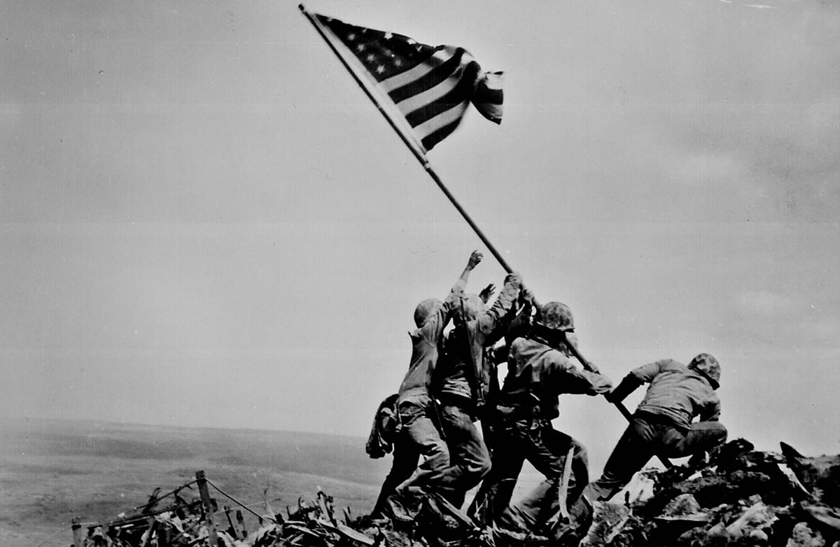 World War II soldiers raising flag